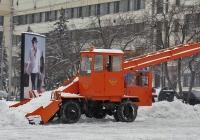 Погрузчик КО-206А на уборке снежной массы. г. Донецк, улица Артёма.