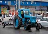 """Трактор Т-40М компании """"Київенерго"""" с одноосным автомобильным прицепом. Киев, Жилянская улица"""