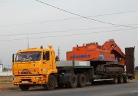 КамАЗ-65116 #К 046 НО 31, на трейлере экскаватор ЕК-270LC. Белгородская область, г. Валуйки, улица Суржикова