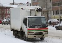 Фургон на шасси Isuzu ELF #Р 983 КТ 45. Курган, улица Максима Горького