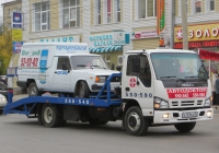 Эвакуатор на шасси Isuzu NQR #Н 793 КХ 45 с фургоном ИЖ-27175 на платформе. Курган, улица Куйбышева