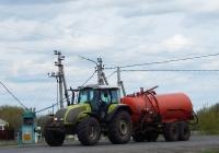 Трактор Valtra T180 с прицепной машиной для внесения жидких органических удобрений . Курская область, Мантуровский район, с. Сейм