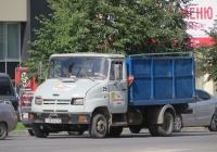 Автомобиль с высокобортной платформой, приспособленной для вывоза мусора на шасси ЗиЛ-5301ПО #О 481 РН 72. Курган, улица Ленина