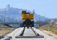 Экскаватор-погрузчик на комбинированном ходу KGT-V. Израиль, Хайфа