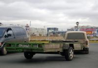 Прицеп #АН 3037 55 в составе автопоезда. Тюмень, улица Мельникайте