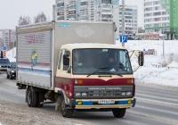 Фургон на шасси Nissan Diesel Condor #О 111 АТ 70. Томск, улица Клюева