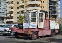 Вилочный эвакуатор с боковой загрузкой. Израиль, Тель Авив