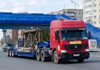 Седельный тягач CNHTC Howo ZZ4257 #М 431 УС 72 с полуприцепом для перевозки спецтехники #АТ 5346 72  . Тюмень, улица Федюнинского
