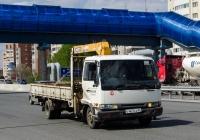 Бортовой грузовой автомобиль с КМУ Nissan #С 461 СА 86 . Тюмень, улица Федюнинского