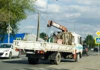 Бортовой грузовой автомобиль с КМУ Nissan Diesel Condor #В 555 ВР 72 . Тюмень, улица Тимуровцев