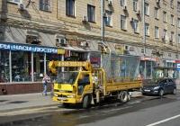 Бортовой грузовой автомобиль Isuzu ELF с КМУ #Т 027 МН 90. Москва, Ленинградское шоссе (дублёр)