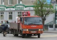 Грузовик с КМУ на шасси Hino Ranger #Е 760 КС 45. Курган, улица Ленина