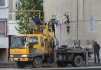 Бурильно-крановая установка на шасси Hino Ranger #Е 502 СУ 42. Курган, улица Бурова-Петрова