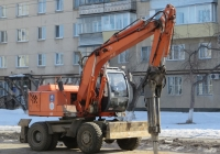 Экскаватор ЕК-12 с гидромолотом.  Курган, улица Куйбышева