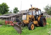 Экскаватор-погрузчик с отвалом на базе трактора ЛТЗ-60А. Псковская область, Великолукский район, Нивы