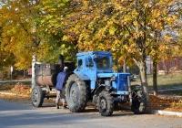 Трактор #825 ТА с прицепом для разогревания смолы. Приднестровье, Тирасполь, улица Юности