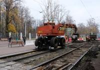 Погрузчик-экскаватор на комбинированном ходу ЭО-3322. Москва, улица Зои и Александра Космодемьянских