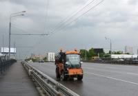 Коммунальная уборочная (поливомоечная) мини-машина Multihog. Москва, Ленинградское шоссе